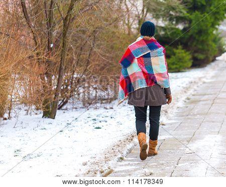 Girl Walking By Sidewalk At Winter