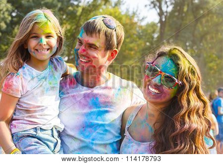 Young family on holi color festival