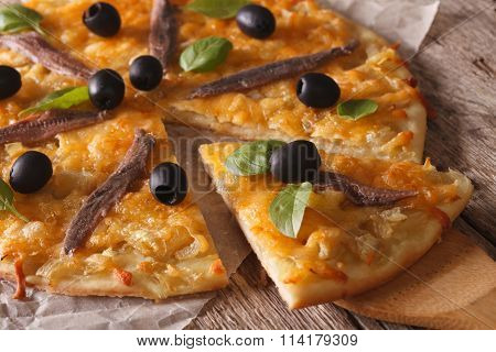 French Pizza With Anchovies And Onions Close-up. Horizontal