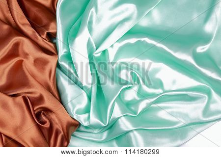 Brown And Light Green Silk Satin Cloth Of Wavy Folds Texture Background