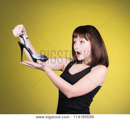 Fashion woman looking at high-heel shoe. Women love shoes concept. Screaming girl and high heels sho