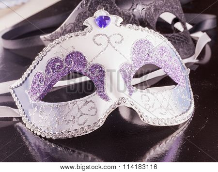 Venetian Mask Over Black Reflecting Surface