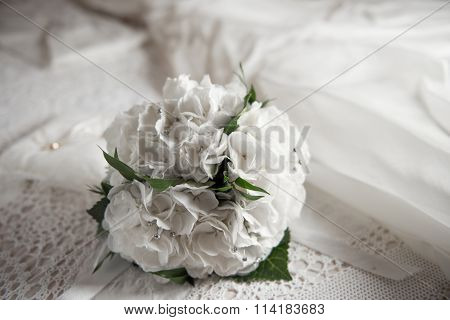 bridal boquet on the bed