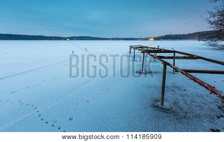 Frozen Lake With Old Destroyed Boats Hoist