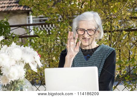 90 Years Old Woman Waving While Having A A Video Call