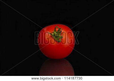 Tomato against black background