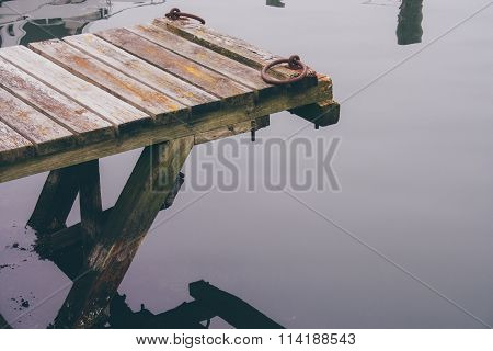 Wooden Pier On A Foggy Day On A Swedish Island