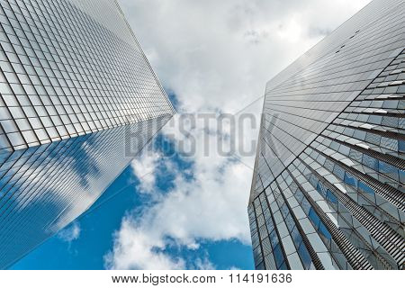 NEW YORK - AUGUST 27: Exterior facade One World Trade Center looking up from below with reflections of the blue sky and clouds in the glass. August 27, 2015 in New York.