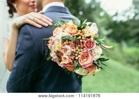 Bride Holding Wedding Bouquet And Hug Groom On Wedding Ceremony