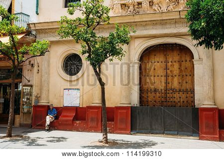 Man sitting near entrance to church at hospital San Juan de Dios