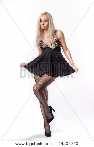 Blonde Model In Sexy Short Black Dress And Pantyhose