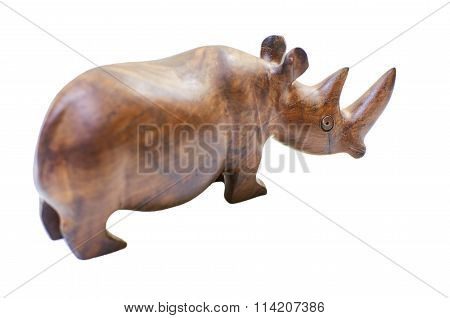 Rhinoceros rhino sculpture made of carved brown wood isolated over white background