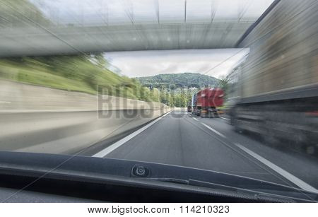 Car That Overtake A Truck In Motorway