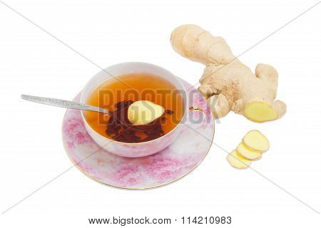 Ginger Tea On A Background Of Ginger Root