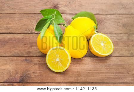 Several Whole Lemons And One Lemon, Cut In Half