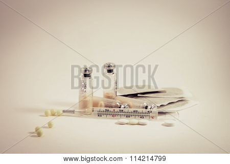 Medical and medication vials against a white background
