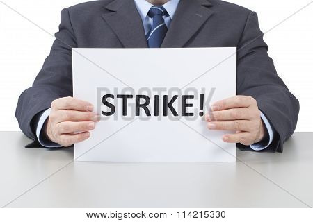 Man Holds A Sheet With A Text Strike - With Clipping Path