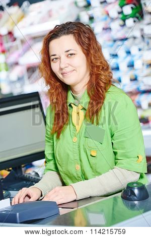 supermarket cashier worker at check out cashdesk in shop store