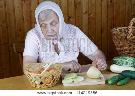 Grandma Cuts Onions And Cucumbers