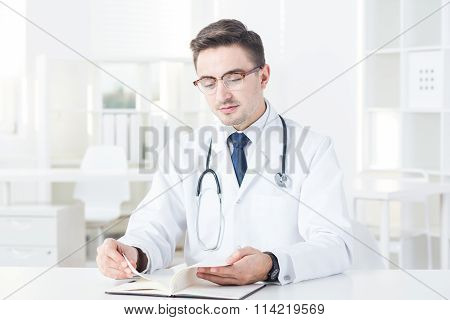 Doctor And His Notebook