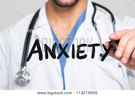 Doctor writing the word Anxiety