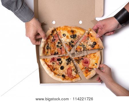 Group of young friends taking pizza slices, top view isolated on white background