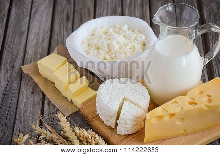 Fresh dairy products. Milk, cheese, butter and cottage cheese with wheat