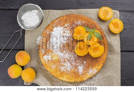 Cottage Cheese Pie With Apricots On Brown Wooden Background. Top View