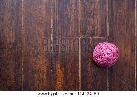 Pink Skein Over Wooden Background