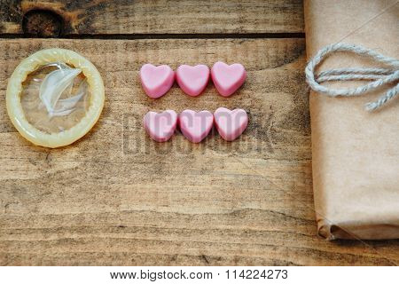Condom, heart shapes and gift box
