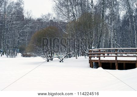 View To Wooden Railings From Frozen River