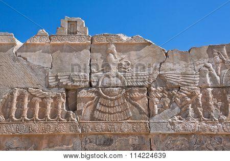 Ahura Mazda - Relief Of Winged Sun Symbol Of Zoroastrianism In Ruined Persepolis
