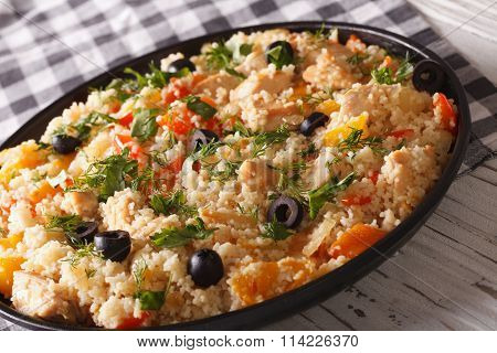 Couscous Salad With Chicken, Olives And Vegetables Close-up. Horizontal