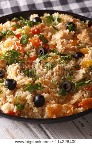 Couscous Salad With Chicken, Olives And Vegetables Close-up. Vertical