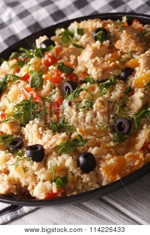 Couscous With Chicken, Olives And Vegetables Close-up. Vertical