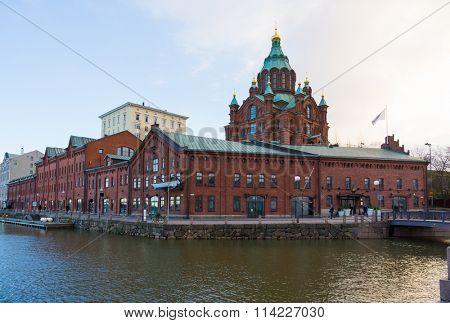 HELSINKI, FINLAND - DECEMBER 26, 2015: Tourists visit Uspenski Cathedral at daytime on December 26, 2015 in Helsinki, Finland