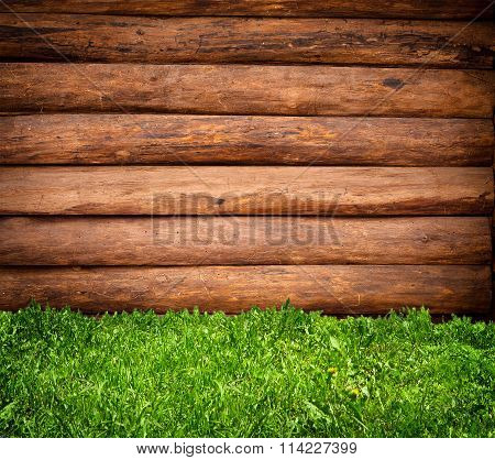 Fresh Spring Green Grass Over Wood Fence Background