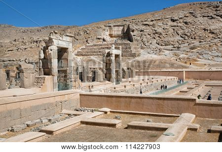 Tourists Watching The Territory Of The Famous Ruined Persepolis City In Mountains