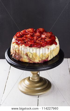 Strawberry Cottage Cheese Cake On Supports For Pie On A Wooden Background