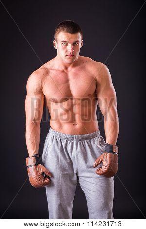 Muscular man bodybuilder. Man posing on a black background