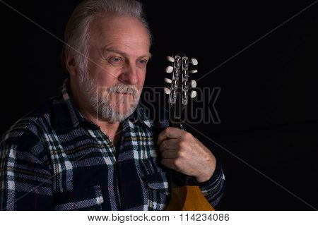 Bearded elderly man with mandolin