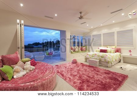 Spacious Bedroom With An Oval Sofa