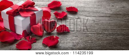 Gift box and bunch of red roses on rustic  wood,Valentine background.
