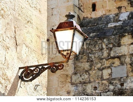Beautiful Old Street Light From Benedictine Monastery Build In Romanesque Style In Sant Cugat, Spain