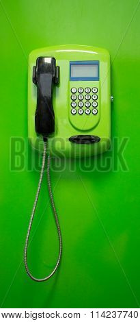 Green Payphone  On A Green Background