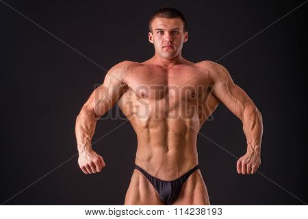 Muscular man bodybuilder. Man posing on a black background