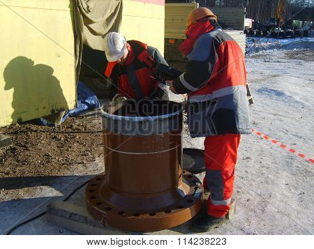 Russia, Sakhalin  - 12 November 2014: survey of quality of processing of future place of welding.