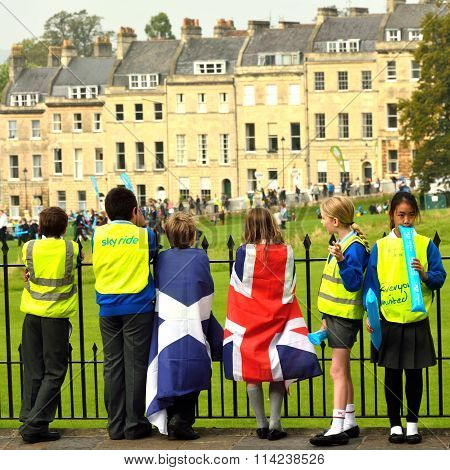 Children in flags watching Tour of Britain