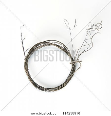 Old guitar strings, isolated on white. old guitar strings coiled.