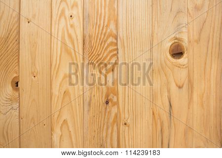 Wood, pine board on a brown background